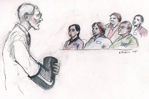 "In his opening statement to the jury, Plaintiffs' lead counsel Dennis Cunningham shows the jury one of the ""black bear"" lockboxes used by activists when they were swabbed and sprayed with pepper spray in 1997. Courtroom graphics by K. Rudin."